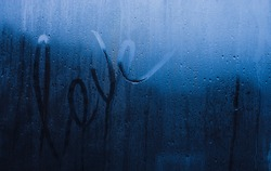 inscription at a wet window