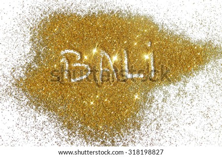 Inscription Bali on golden glitter sparkle on white background
