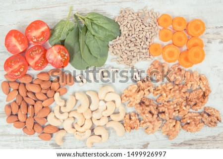 Inscription biotin with healthy products and ingredients as source vitamin B7, dietary fiber and natural minerals, concept of nutritious eating