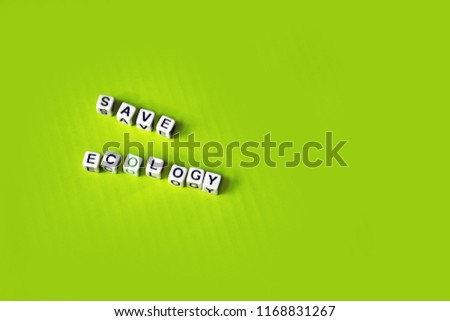 inscription from cubes save ecology on a green background #1168831267
