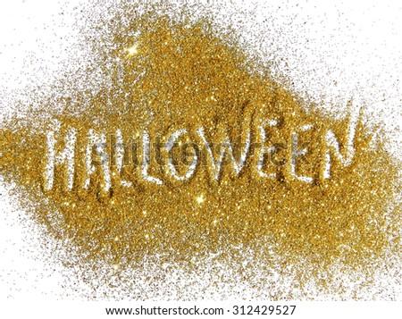 Inscription Halloween on golden glitter sparkles on white background
