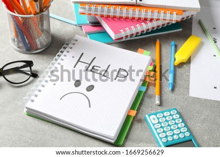 Inscription Help and stationary on grey background, close up Stock photo ©