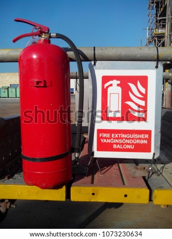 Inscription in English and Azeri: fire extinguisher