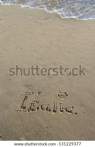 Inscription Italia on the wet sand - stock photo