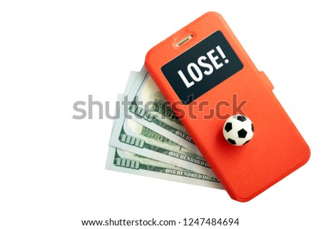 Inscription LOSE on the screen of a smartphone. The concept of losing sports betting. A football ball and a mobile phone in a red case lie on three hundred US dollars on a white background. Isolate.