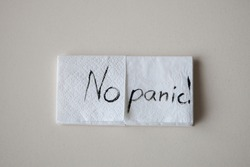 inscription no panic on a napkin