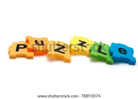 Inscription of colorful puzzles - Puzzle, isolated on white.
