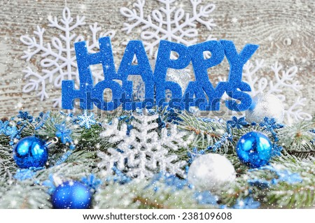 Stock Photo Inscription of happy holidays with christmas decorations