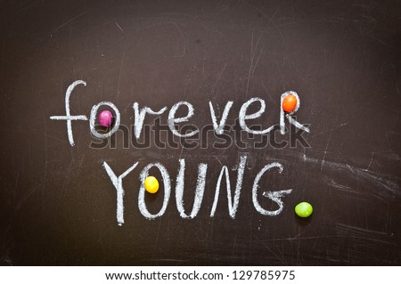 Inscription on a blackboard FOREVER YOUNG