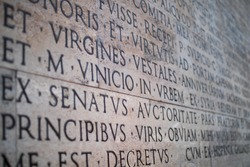Inscription on a marble slab in Rome with the detail on Virgines. Virgin