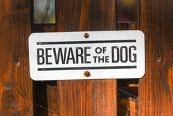 Inscription on the fence: Beware of the dog.