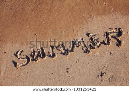 inscription on the sand, Inscription on the bank of the ocean summer #1031253421