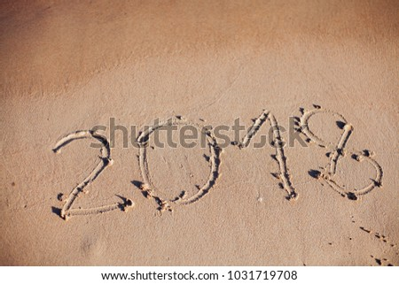 inscription on the sand, the inscription on the shore of the ocean in the summer of year #1031719708
