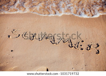 inscription on the sand, the inscription on the shore of the ocean in the summer of year #1031719732