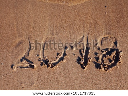 inscription on the sand, the inscription on the shore of the ocean in the summer of year #1031719813