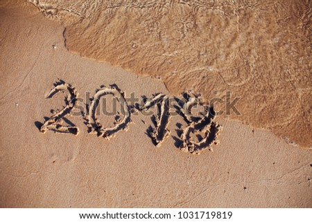 inscription on the sand, the inscription on the shore of the ocean in the summer of year #1031719819