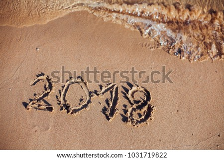 inscription on the sand, the inscription on the shore of the ocean in the summer of year #1031719822