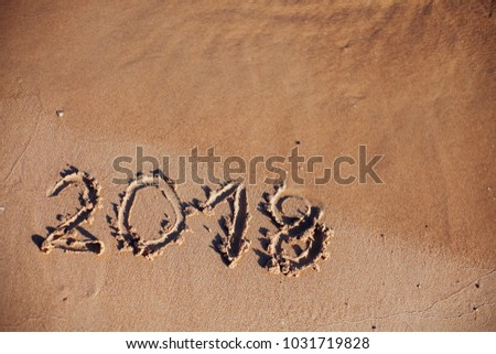 inscription on the sand, the inscription on the shore of the ocean in the summer of year #1031719828