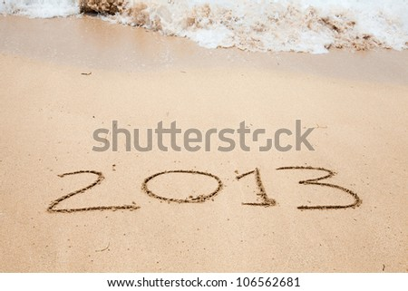 "Inscription on the sea coast ""2013"" #106562681"