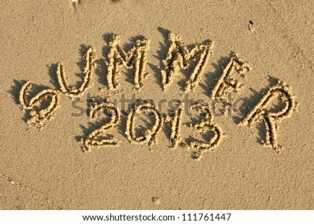 Inscription on wet sand Summer 2013