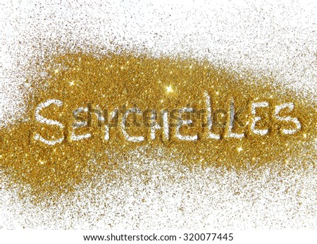 Inscription Seychelles on golden glitter sparkle on white background