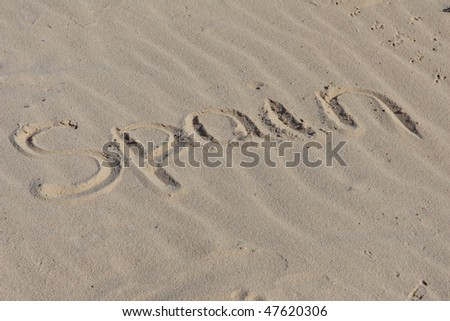 "Inscription ""Spain"" on a sand."