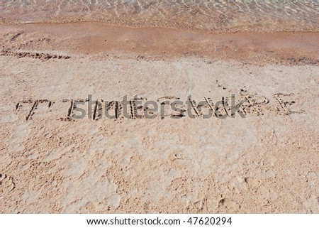 "Inscription ""TimeShare"" on a sand."