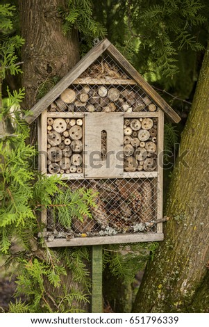 Insect house in a summer garden #651796339