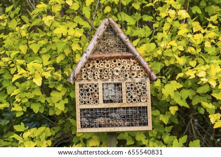 Insect house in a summer garden #655540831