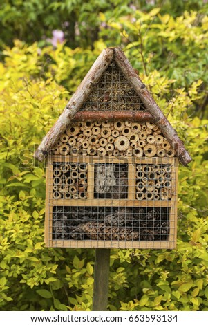 Insect house in a summer garden #663593134