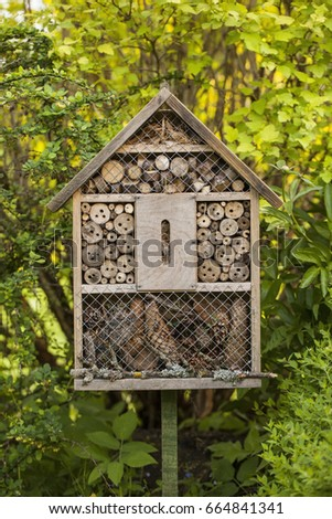 Insect house in a summer garden #664841341
