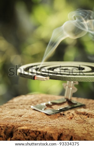 Insect repellent mosquito coil in closeup. - stock photo