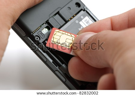 Inserting a sim card into the back of a mobile phone