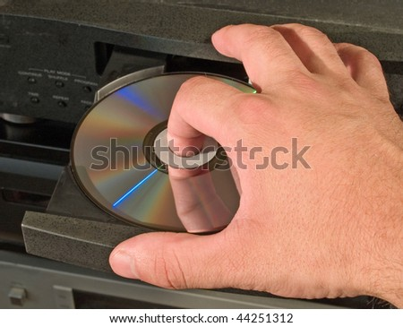inserting dvd disk in player