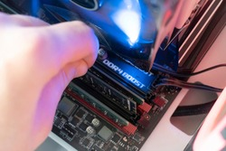 inserting plug in the ram ddr memory card in the computer mainboard, random access memory