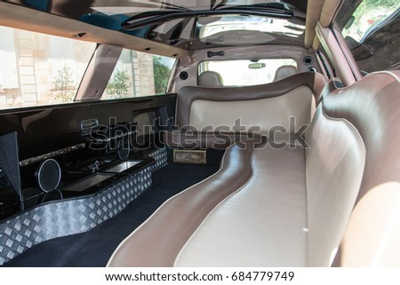 Inside a beautiful  limousine white and brown - luxury limo interior