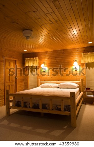 Inside a bedroom in cabin made entirely of wood