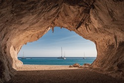 Inside a cave at Cala Luna beach on the Italian island of Sardinia