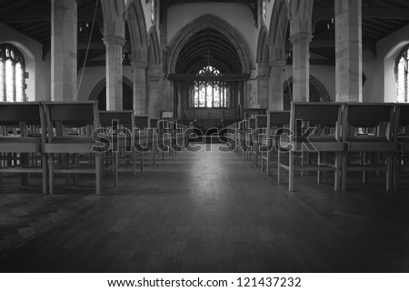 inside a church in england, view from the back looking down to the altar