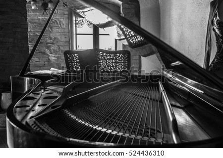 inside a grand piano in an old...