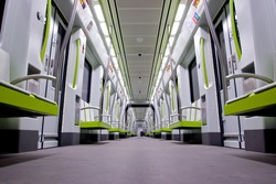 Inside a green empty subway car