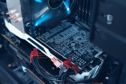 Inside a high performance computer. motherboard and CPU cooling fans illuminated by internal LEDs inside a server computer. Concept of computer repair and modern technology