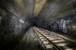 Inside a long abandoned Baltimore and Ohio Railroad tunnel west of Washington, Pennsylvania, with rails and ties intact.