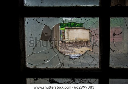 inside abandoned house with broken glass old window #662999383