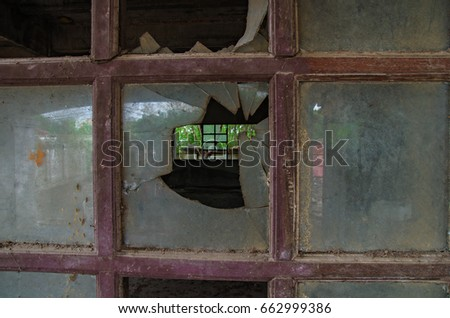 inside abandoned house with broken glass old window #662999386