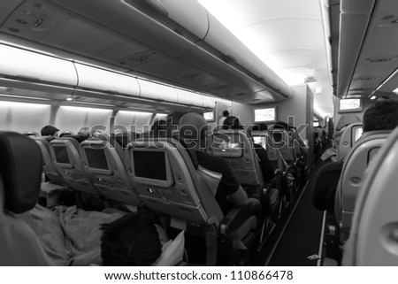 Inside an airplane with passengers