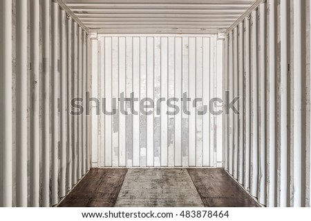 Inside an empty shipping container