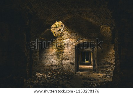Inside ancient ruined medieval brick temple interior with arches and corridors, dark toned  #1153298176
