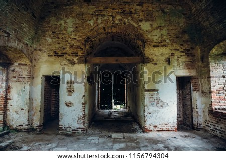 Inside ancient ruined medieval brick temple interior with arches, doors and corridors, dark toned  #1156794304