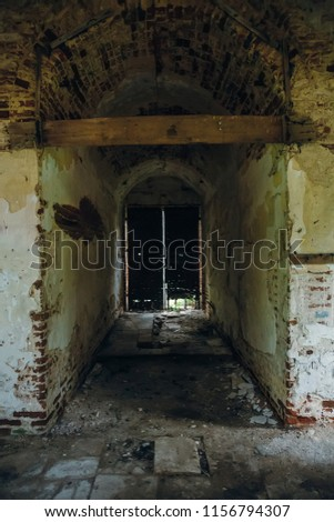 Inside ancient ruined medieval brick temple interior with arches, doors and corridors, dark toned  #1156794307